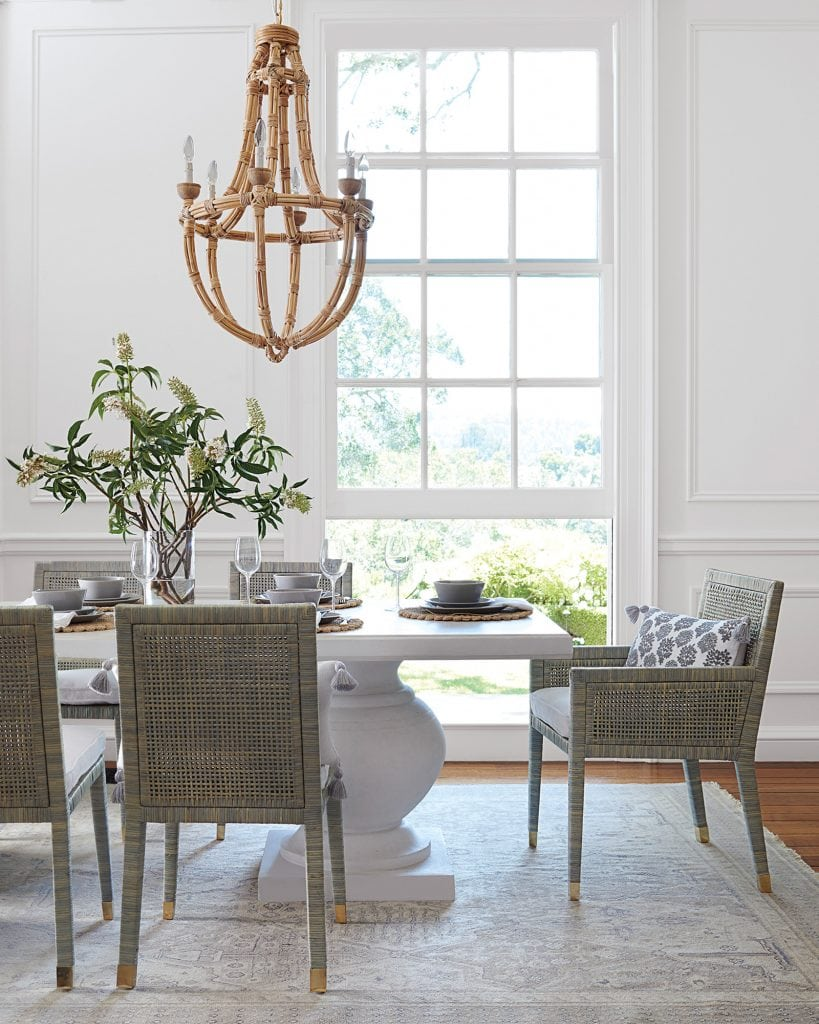 Classic dining room style with grey dining chairs and whitewash pedestal dining table on Thou Swell #diningroom #dining #diningroomdesign #diningroomstyle #serenaandlily