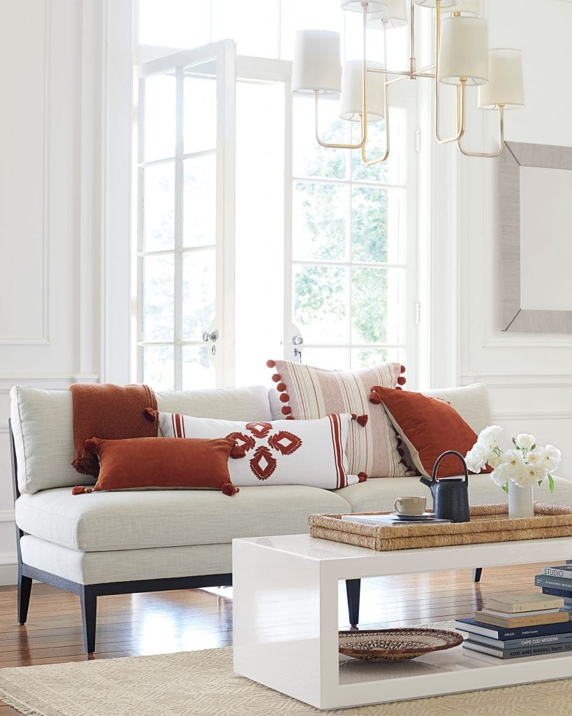 Red and white living room with throw pillows styled on armless sofa from Serena & Lily on Thou Swell #sofa #pillows #throwpillows #sofa #armlesssofa #redandwhite #homedecorideas