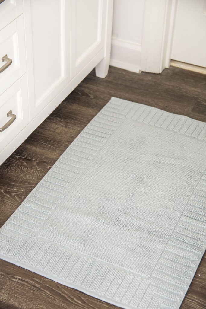 Super soft light blue bath towel set from Serena & Lily in white bathroom on Thou Swell #towels #bathtowels #bluetowels #towelset #bathroomdecor #bathroomdesign #bathroom #serenaandlily