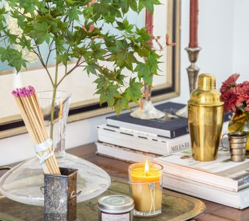 Fall home decor with Votivo Venetian Leather scented candle on desk in the living room by Kevin O'Gara Thou Swell #fall #falldecor #fallhomedecor #homedecor #falldecor #decorideas #homedecorideas #hygge #hyggedecor #candle #scentedcandle #fallcandle
