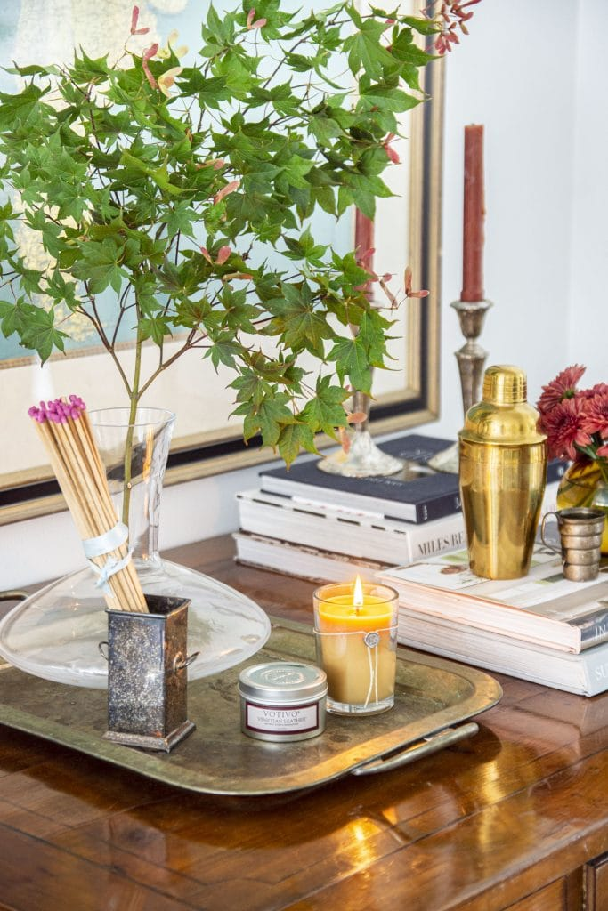 Votivo Venetian Leather fall scented candle on desk in the living room by Kevin O'Gara Thou Swell #fall #falldecor #fallhomedecor #homedecor #falldecor #decorideas #homedecorideas #hygge #hyggedecor #candle #scentedcandle #fallcandle