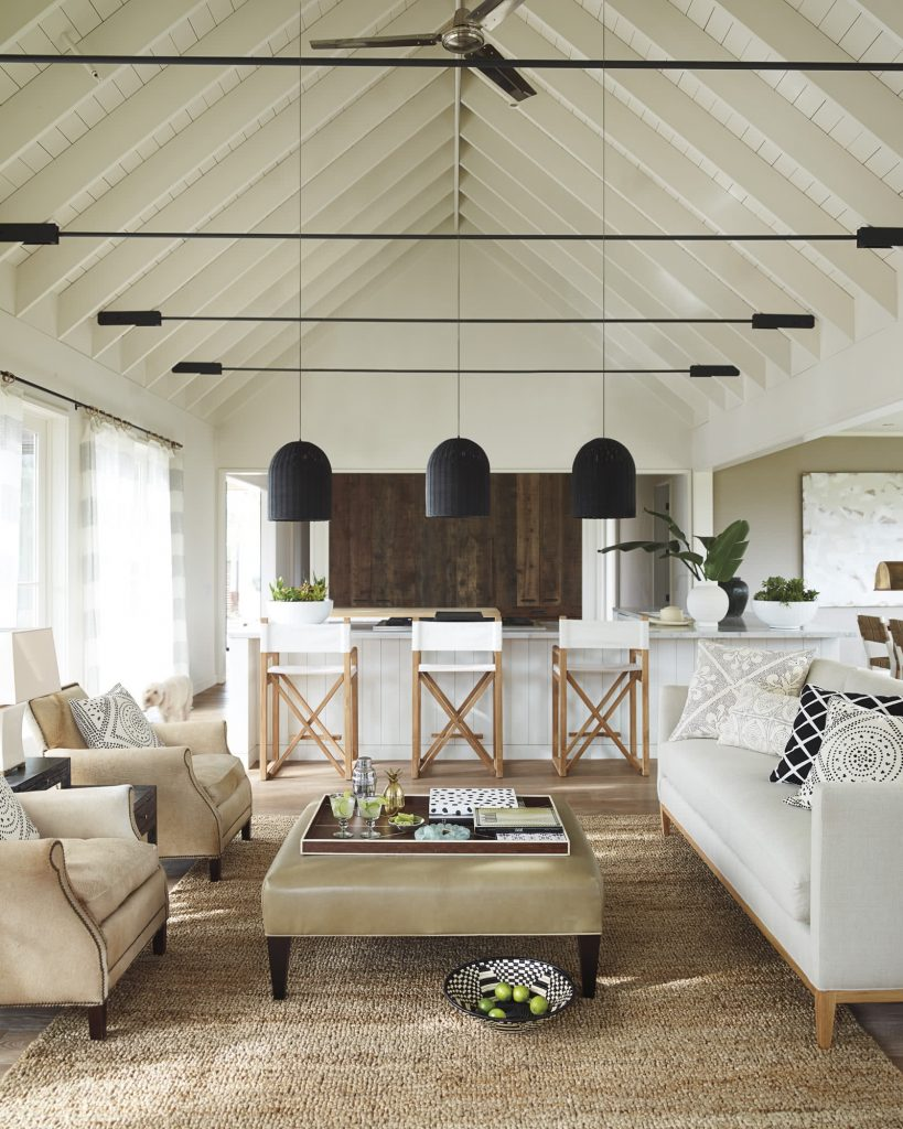A-frame living room with ceiling beams and lake house style from Serena & Lily on Thou Swell #aframe #aframehouse #livingroom #livingroomdesign #homedecor #homedecorideas