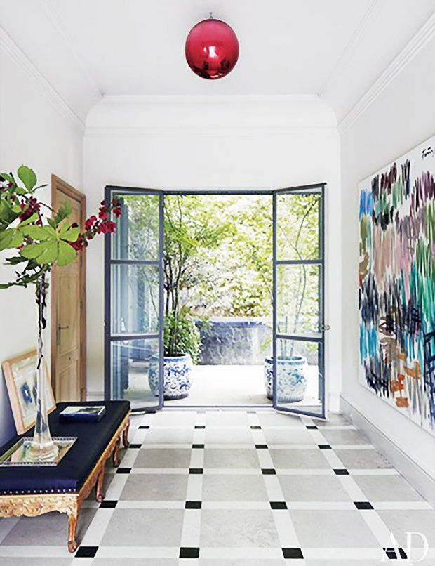 Isabel Lopez Quesada home entryway with steel French doors and abstract painting on Thou Swell #hometour #spanishhome #eclecticstyle #interiordesign #spanishdesign #homedesign #housetour #spanishstyle #homedecorideas