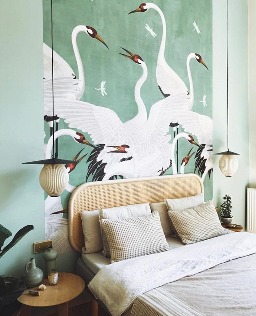 Green bedroom with Gucci green Heron wallpaper and cane headboard on Thou Swell #bedroom #bedroomdesign #interiordesign #heronwallpaper #gucciwallpaper #gucci