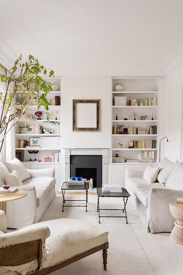 Cream living room design by Maria Santos Studio in spanish apartment in Madrid with facing sofas, linen sofas, cream rug, and greenery on Thou Swell #livingroom #livingroomdesign #creamlivingroom #creamdecor #interiordesign #homedesign