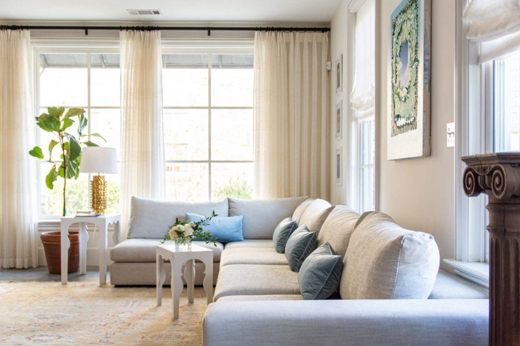Artlce Gaba sofa modular sectional sofa design in apartment living room with big windows, vintage Turkish rug, and blue velvet pillows by Kevin O'Gara on Thou Swell #article #gabasofa #livingroom #livingroomdesign #apartment #apartmentdesign #homedesign #homedecor #interiordesign