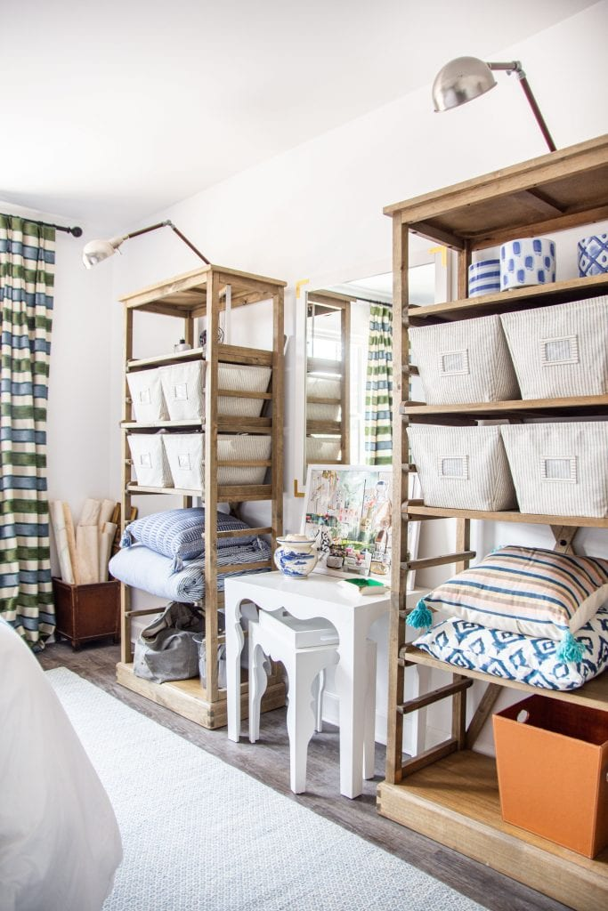Bedroom design with bookshelves, organized baskets, and striped curtains by Kevin O'Gara on Thou Swell #bedroom #bedroomdesign #bedroomdecor #interiordesign #atlanta #buckhead #atlantahome #bedroomdecor #decorating #interior