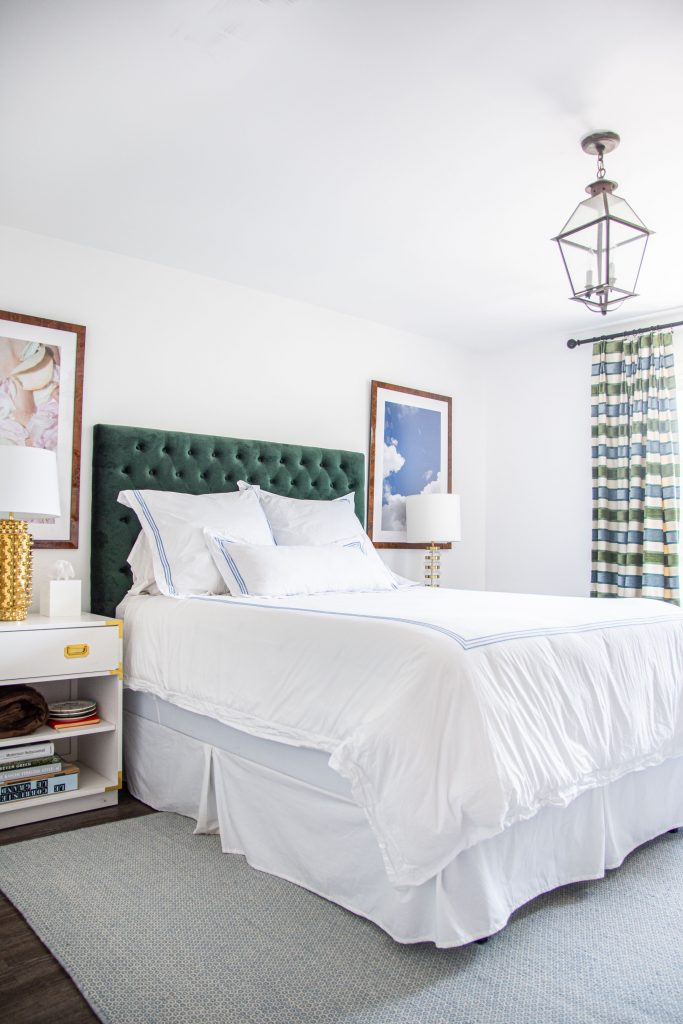 Bedroom design with green velvet headboard, embroidered bedding, and striped curtains by Kevin O'Gara on Thou Swell #bedroom #bedroomdesign #bedroomdecor #interiordesign #atlanta #buckhead #atlantahome #bedroomdecor #decorating #interior