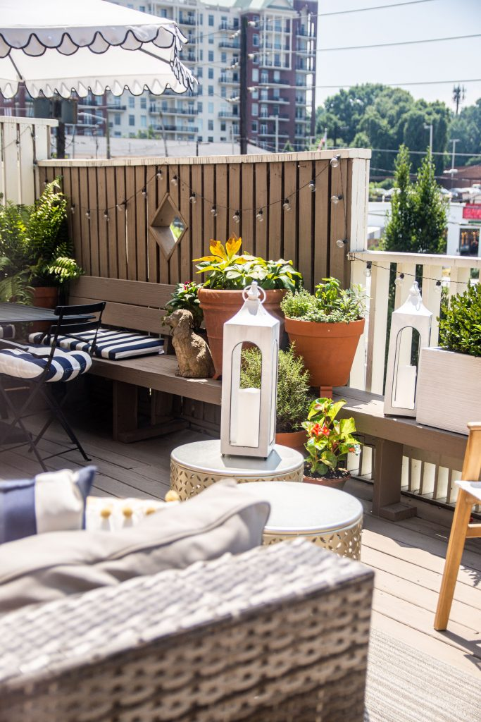 Patio deck design with potted plants and outdoor furniture in Buckhead Atlanta townhouse on Thou Swell #patio #deck #outdoordeck #deckfurniture #deckdesign #buckhead #buckheadatlanta #townhouse #outdoordesign