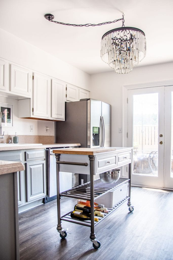 Kitchen makeover with paint, chandelier, floating island, and luxury vinyl plank LVP flooring by Kevin O'Gara on Thou Swell #kitchen #kitchendesign #kitchenmakeover #homedesign #makeover #designmakeover #interiordesign #kitchendecor