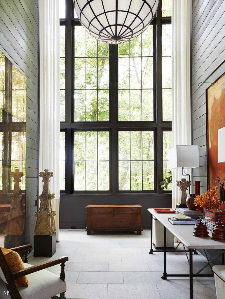 McAlpine House tall entry hall with double-story iron window and globe pendant light with grey walls on Thou Swell #hall #hallway #entry #entryhall #greywalls #interiordesign #architecture