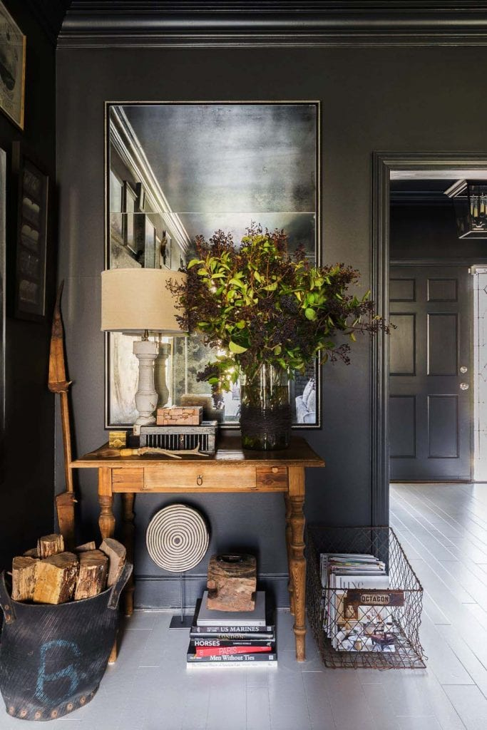 Moody dark grey hallway vignette side table with antiqued mirror on Thou Swell #grey #greywalls #greypaint #greyroom #vignette #interior #interiordesign