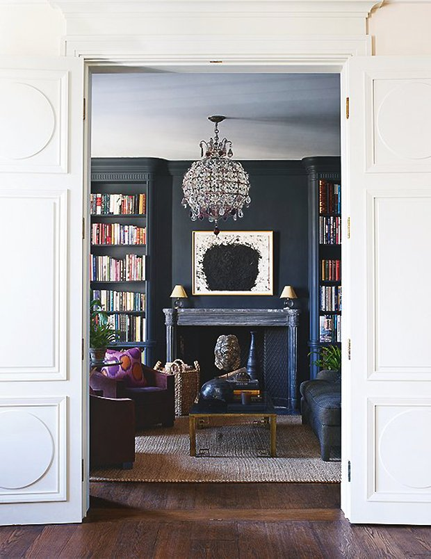 Aerin Lauder's home in New York City with a dark grey living room on Thou Swell #aerin #aerinlauder #newyorkcity #townhouse #uppereastside #interiordesign #luxurydesign #interior #homedesign