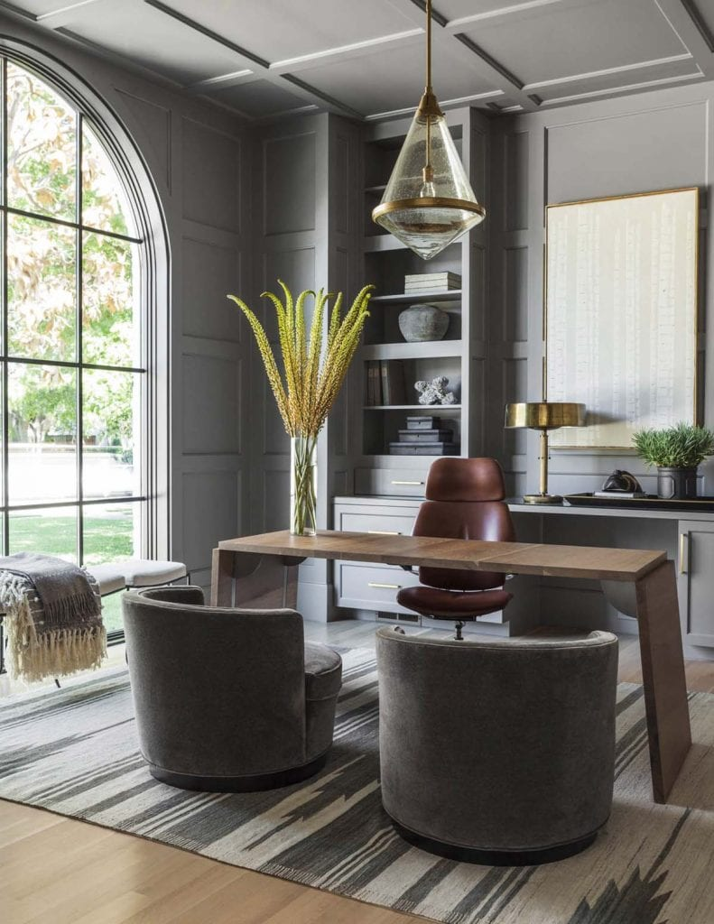 Grey home office design with arched window and barrel chairs on Thou Swell #office #homeoffice #officedesign #greyoffice #greyroom #greywalls #greypaint #homedecor #homedesign #interiordesign
