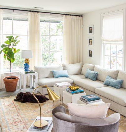 Modern living room accents from AllModern with cream velvet ottoman stools, grey velvet bucket chair, and vintage Turkish rug by Kevin O'Gara on Thou Swell #livingroom #livingroomdecor #modernaccents #allmodern #decor #homedecor #homedesign #livingroomdesign #interiordesign