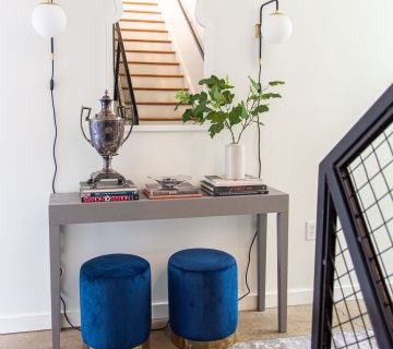 Modern entryway design with AllModern grey console table, blue velvet stools, and sconce lights on Thou Swell #entry #entryway #entrywaydesign #entrywaydecor #entrydesign #allmodern