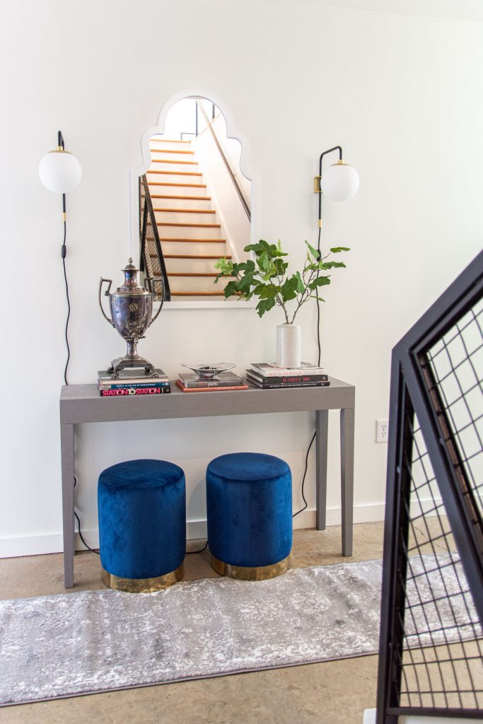 Modern entryway decor with AllModern grey console table, blue velvet stools, and sconce lights on Thou Swell #entry #entryway #entrywaydesign #entrywaydecor #entrydesign #allmodern
