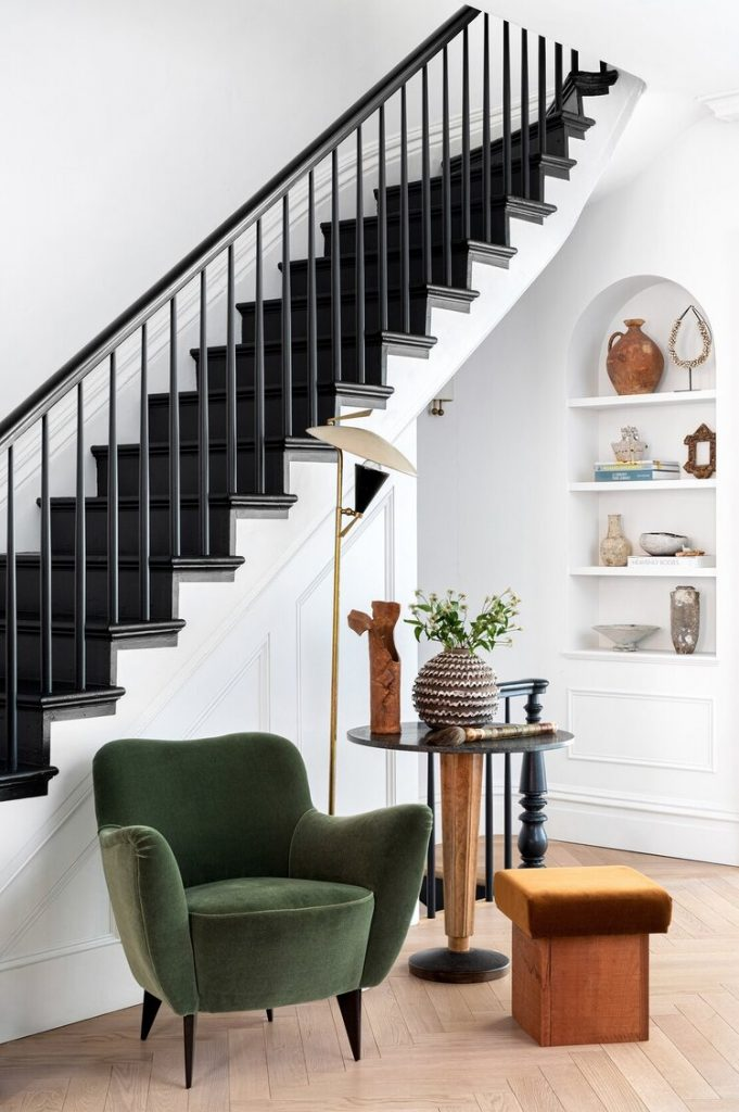 Athena Calderone Brooklyn townhouse black stairs and velvet green armchair on Thou Swell #brooklyn #townhouse #interiordesign #stairs #paintedstairs #blackstairs