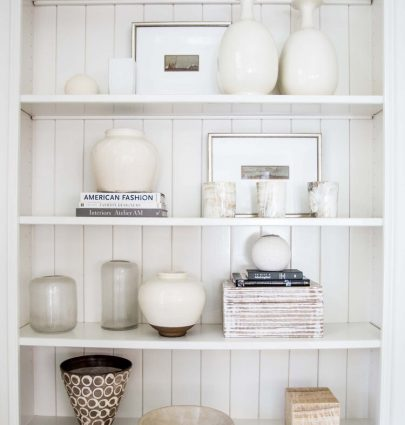 Suzanne Kasler Interiors white shelf styling home decor accessories by Kevin O'Gara Photography interior photographer in Atlanta