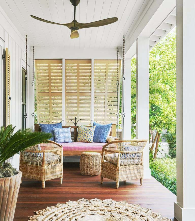 Porch design in a tropical house in South Carolina full of wallpaper, Southern home tour on Thou Swell #tropicalhouse #tropicalwallpaper #wallpaper #southernhouse #homedecor #homedesign #housetour #interiordesign
