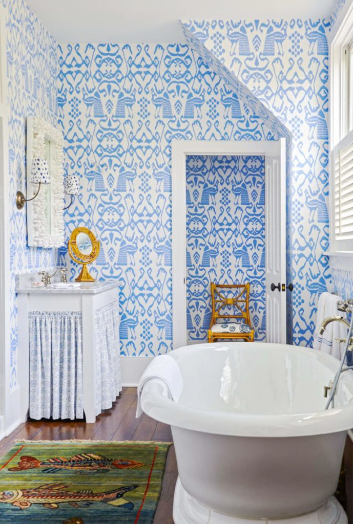 Blue bathroom wallpaper in a tropical house in South Carolina full of wallpaper, Southern home tour on Thou Swell #tropicalhouse #tropicalwallpaper #wallpaper #southernhouse #homedecor #homedesign #housetour #interiordesign