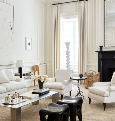 White living room design with layers of cream, tan, and black in New York townhouse with tall ceilings by Alyssa Kapito on Thou Swell #