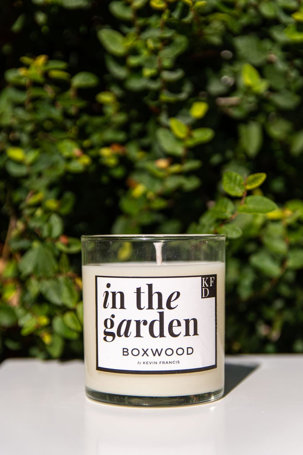 IN THE GARDEN scented candle collection inspired by the traditional Southern garden with boxwood, hydrangea, jasmine, damask rose, and jasmine by Kevin Francis Design #southerngarden #garden #gardening #candles #scentedcandle