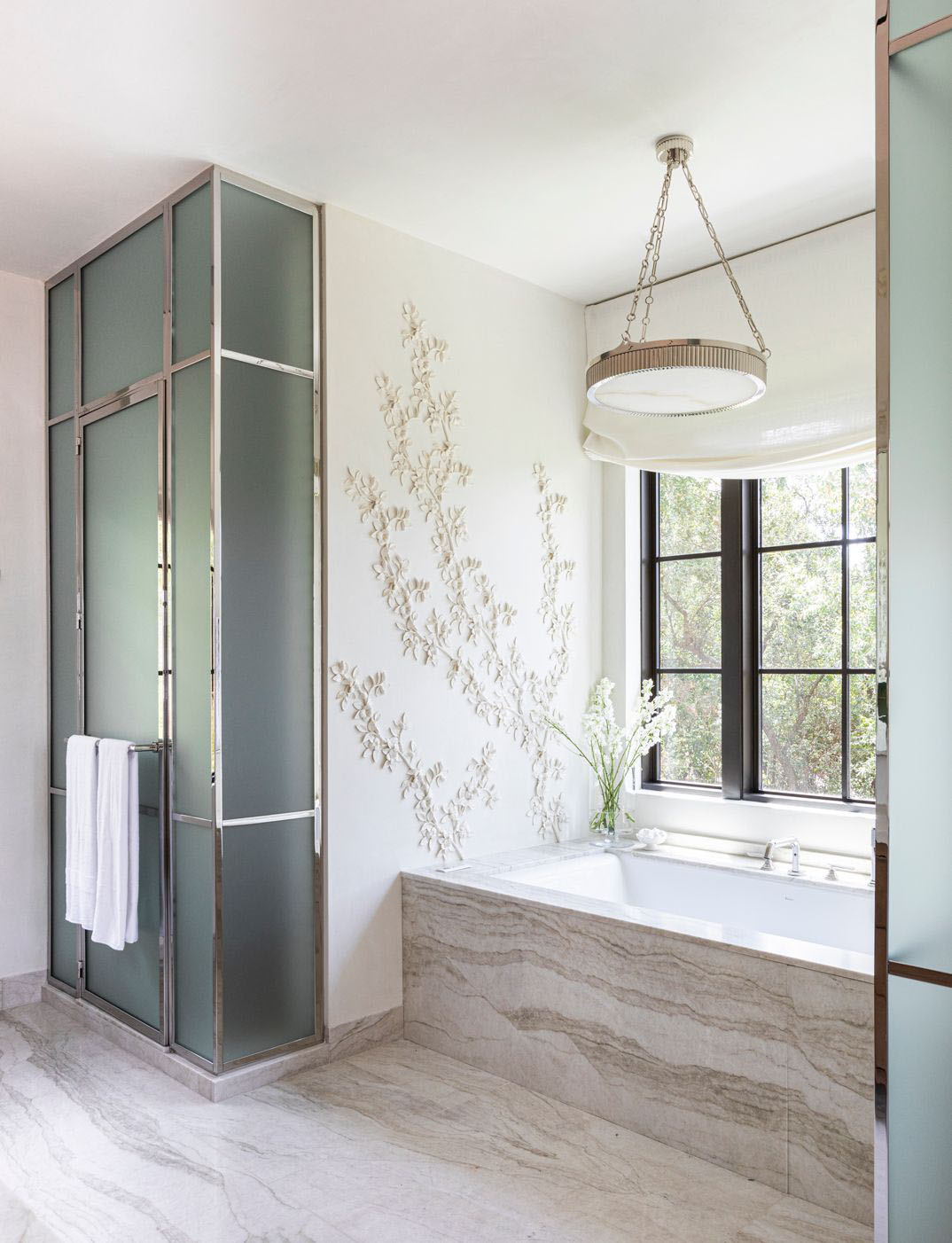 Houston home tour full of warm textures by Marie Flanigan, modern Houston house, luxury bathroom with plaster flowers on Thou Swell #bathroom #luxurybathroom #designerbathroom #bathroomdesign #bathroomdecor #homedesign