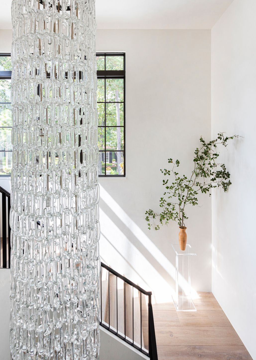Houston home tour full of warm textures by Marie Flanigan, modern Houston house, stairwell design with long chandelier on Thou Swell