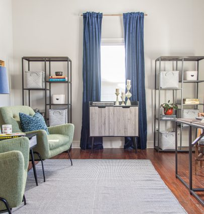 Home office makeover with the Queer Eye furniture line at Walmart, blue curtains, mid-century modern design, green armchairs, and charging desks by Kevin O'Gara on Thou Swell #queereye #queereyefurniture #office #homeoffice #homeofficedesign #homeofficemakeover #makeover #homemakeover #homedecor #homedecorideas #officedecor
