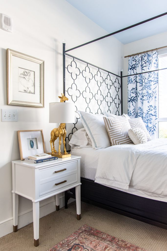 Behr Swiss Coffee, a best off-white paint color for walls in a blue and white bedroom by Kevin O'Gara #swisscoffee #behrpaint #whitepaint #paintingideas #paintcolors #bedroomdesign #warmwhite #homedecorideas #interiordesign