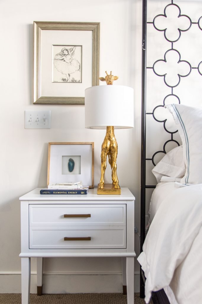 Behr Swiss Coffee, a popular warm white paint color for walls in a blue and white bedroom by Kevin O'Gara #swisscoffee #behrpaint #whitepaint #paintingideas #paintcolors #bedroomdesign #warmwhite #homedecorideas #interiordesign