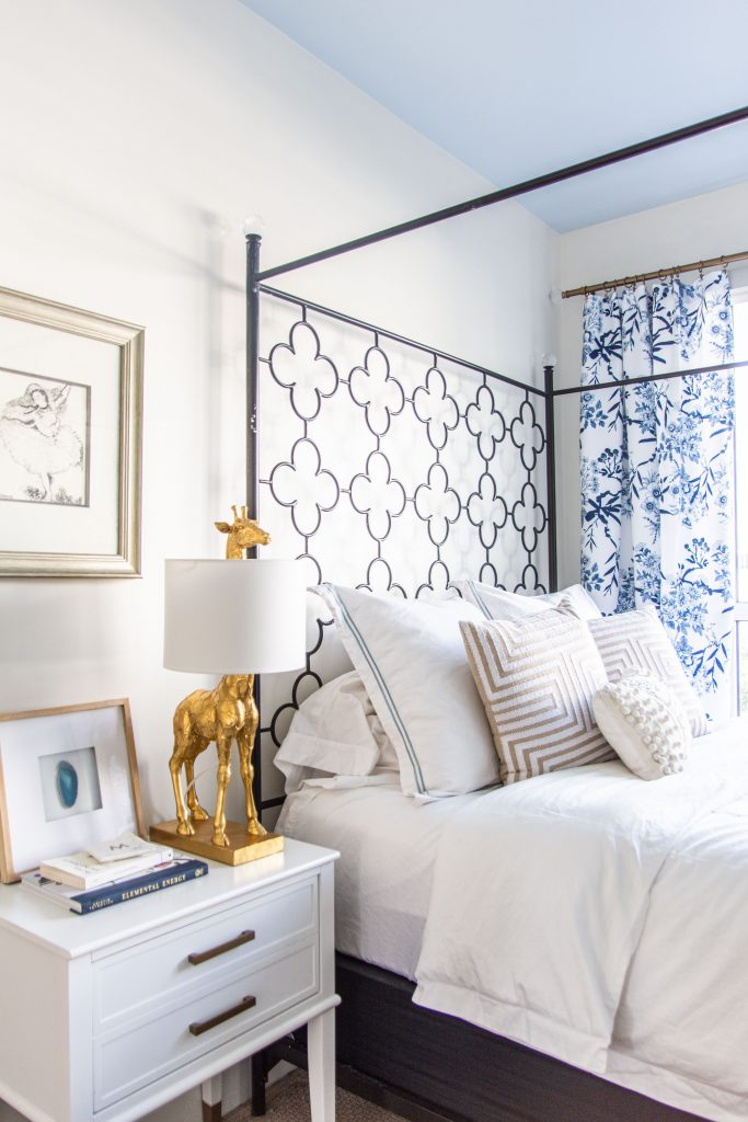 Behr Waterfall serene light blue wall color and sky blue ceiling paint in a bedroom by Kevin O'Gara #blueceiling #bluepaint #waterfall #lightblue #blueandwhite #bedroom #bedroomdesign #interiordesign #homedecorideas