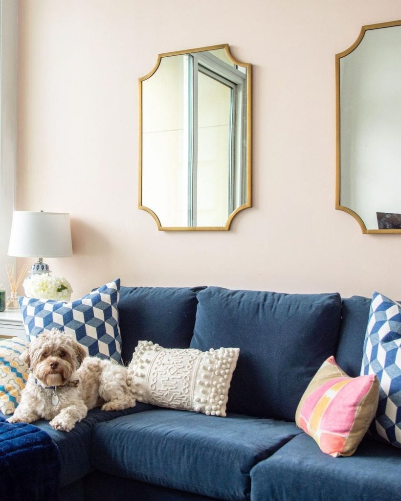 Clare Wing It pale pink paint color for walls in living room pink accent wall by Kevin O'Gara #clare #clarepaint #palepink #pink #pinkpaint #pinkwall #livingroom #interiordesign #homedesign