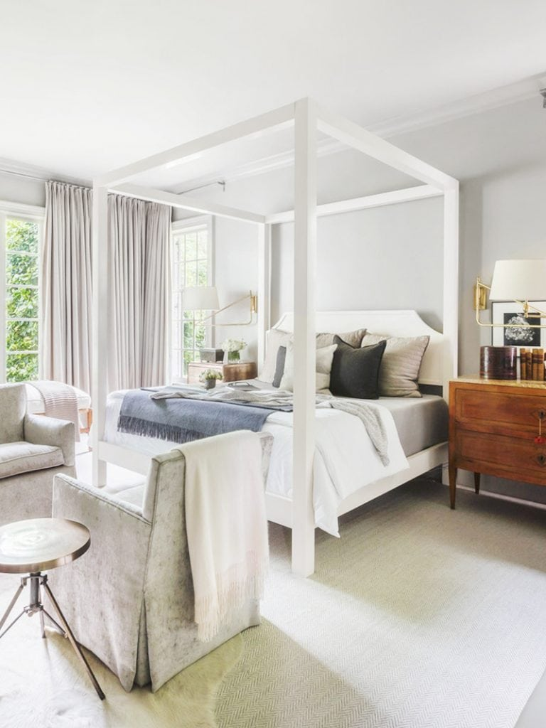 Soothing master bedroom with white canopy bed in elegant Memphis home tour on Thou Swell #hometour #housetour #traditionalhome #interiordesign #homedesign #homedecorideas #traditionaldesign #homedecor