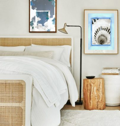 Blue and white collage art prints by Kevin Francis Design in a bedroom design with wicker bed #artprint #artwork #wallart