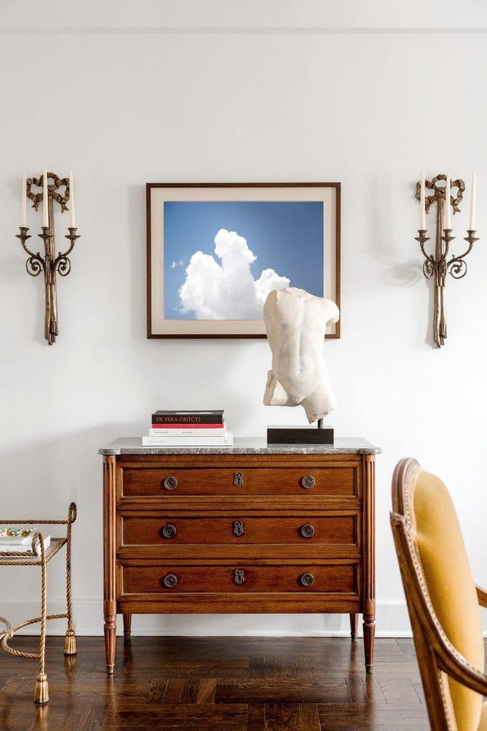 Cloud photography art print by Kevin O'Gara above antique dresser in New York apartment design on Thou Swell #clouds #sky #photography #artprint #homedecor #homedecorideas #homedesign
