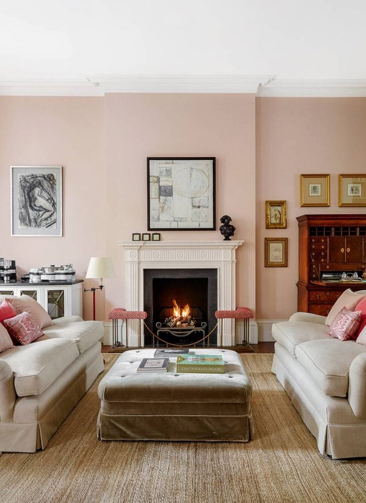 Pink London living room design with blush pink walls, tan sofas facing each other by fireplace on Thou Swell #pinkroom #pinkwalls #livingroom #livingroomdesign #pinkpaint #homedecor #homedecorideas