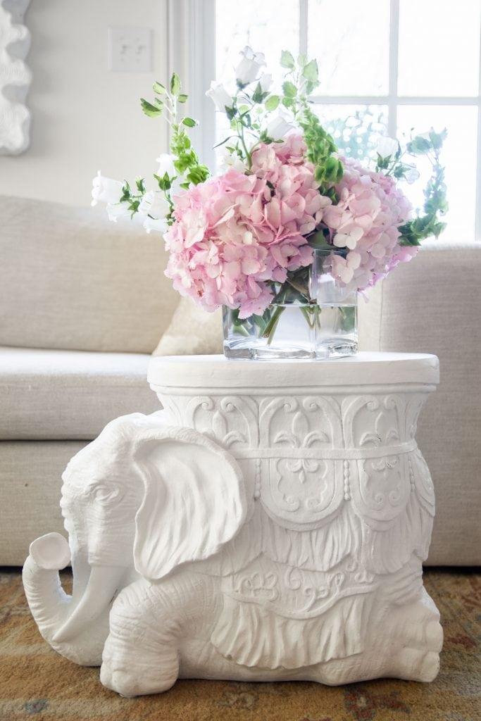 Matte white elephant side table, plaster style white stool table, elephant figurine stool table by Kevin Francis Design #elephant #whiteelephant #mattewhite #whiteplaster #sidetable #furniture #design