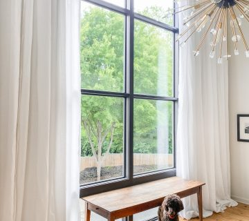 Custom tall sheer white linen curtains for double-story living room window on Thou Swell #curtains #drapery #linen #livingroom #livingroomdesign #livingroomdecor #homedecorideas