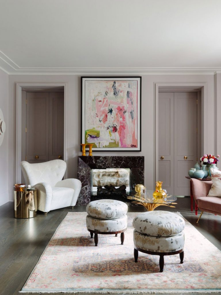 Dusty pink living room design with velvet curved sofa, shearling armchair, pink oriental rug, and abstract painting on Thou Swell #pinkroom #dustypink #livingroom #pinkroom #homedesign #homedecorideas